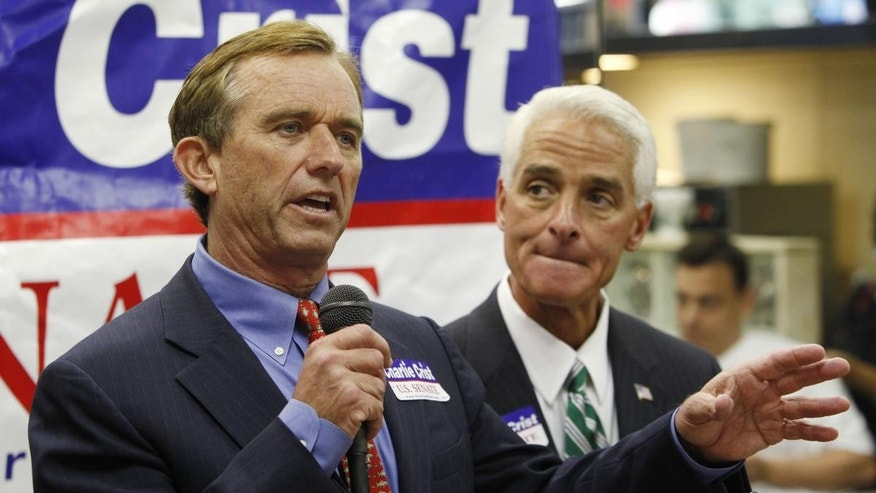 Robert F. Kennedy Jr., left, gestures as he speaks during a news conference as he endorses Gov. Charlie Crist, right, in Crist's independent candidacy for the Senate, Wednesday, Oct. 13, 2010 at Shelby's Kitchen & Deli in Deerfield Beach, Fla. (AP Photo/Wilfredo Lee)