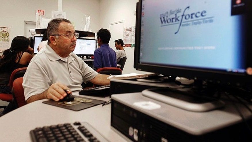 Sept. 2, 2010: Job seeker Jose Jaramillo , of Hialeah, works the computer as he looks for employment at the South Florida Workforce office in Hialeah Gardens, Fla. Applications for jobless benefits rose last week for the first time in three weeks.