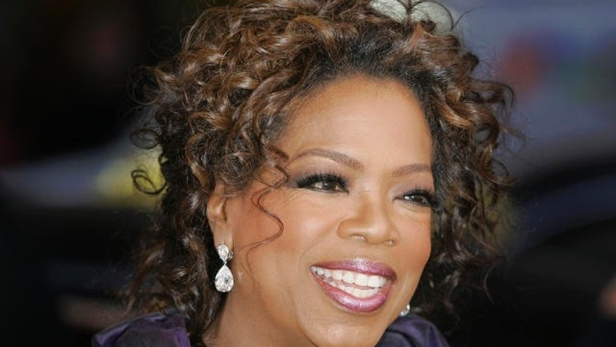 "Talk show host Oprah Winfrey smiles as she talks to reporters before for the Chicago premier of ""The Color Purple"" Thursday, May 3, 2007. (AP Photo/Charles Rex Arbogast)"