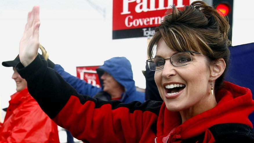 Palin Waves to Supporters in Anchorage, AK (AP File Photo)