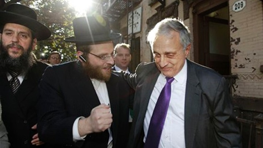Rabbi Yechezkel Roth, left, and another Orthodox Jewish supporter, center, accompany New York Republican gubernatorial candidate Carl Paladino in the Williamsburg neighborhood of Brooklyn Oct. 10. (AP Photo)