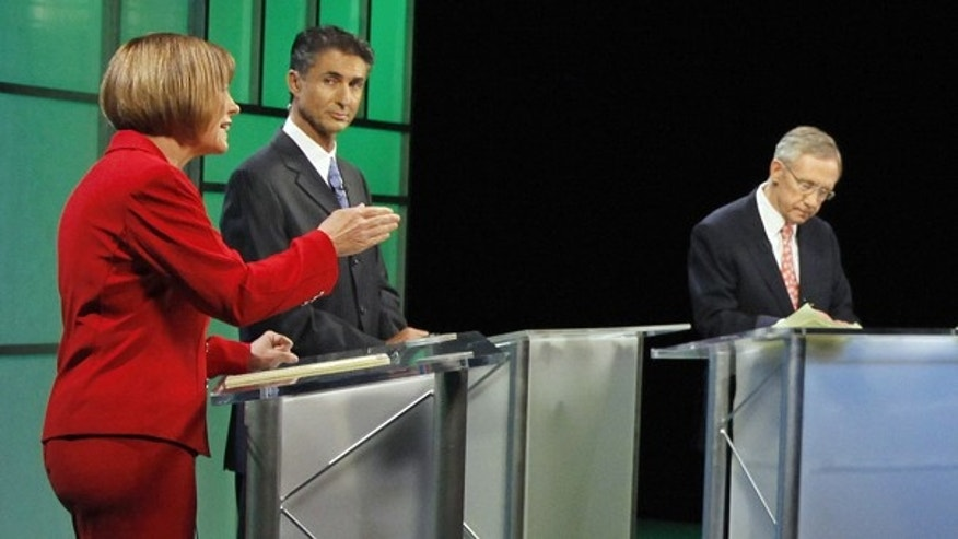 Oct. 14: Republican Senate candidate Sharron Angle, left debates Senate Majority Leader Harry Reid in Las Vegas.