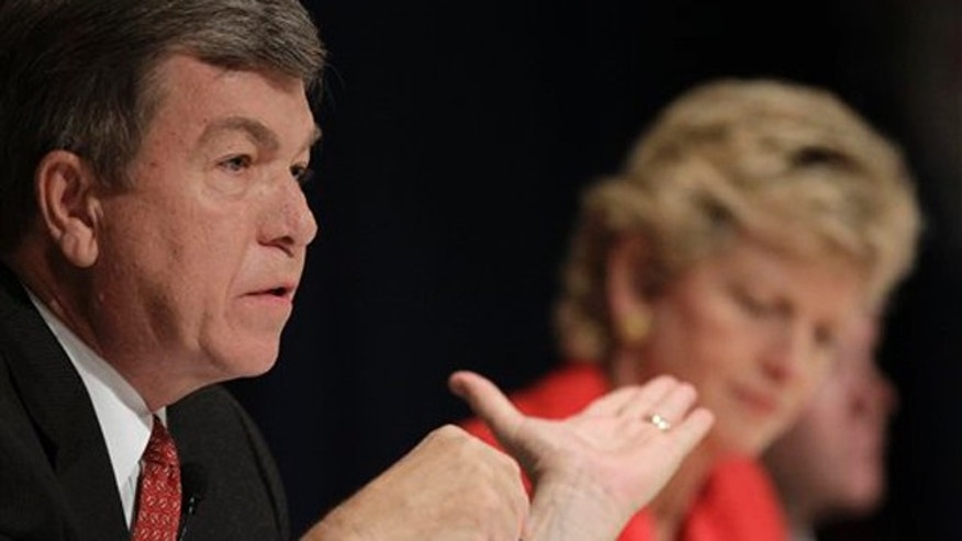 Republican Missouri Senate candidate Roy Blunt responds to Democratic candidate Robin Carnahan, right, during a debate Oct. 15 in Lake Ozark, Mo. (AP Photo)