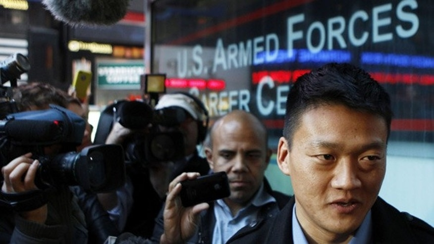 Oct. 19: Discharged U.S. Army Lt. Daniel Choi speaks with the media outside after attempting to re-enlist at the Times Square military recruitment station in New York.