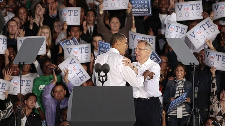 Oct. 22: President Obama, left, greets Nevada Sen. Harry Reid after speaking in support of Reid at a rally in Las Vegas.