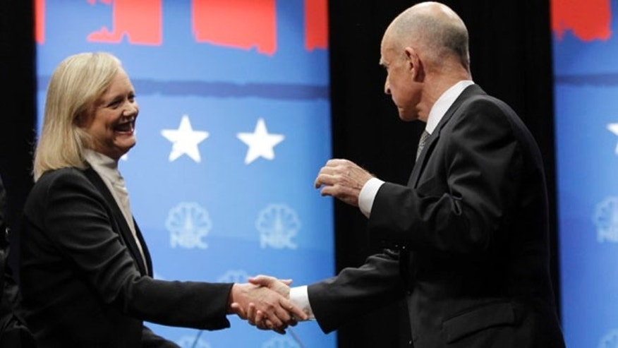 Oct. 12: California gubernatorial candidates Democrat Jerry Brown, right, and Republican Meg Whitman, left, shake hands during a debate at Dominican University of California in San Rafael, Calif. Combined, Brown and Whitman have hit record spending at more than $188.1 million in both the primary and general election.