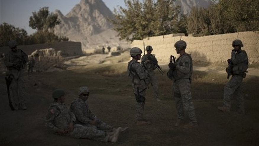 In this Oct. 24 photo, U.S. soldiers from 2nd PLT Diablos 552nd Military Police Company patrol the outskirts of Kandahar City in Afghanistan. (AP Photo)
