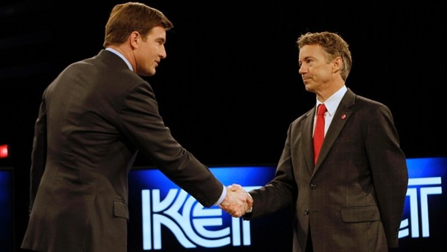 Oct. 25: Democratic U.S. Senate candidate Jack Conway, left, and his Republican counterpart Rand Paul shake hands prior to their final debate in Lexington, Ky.