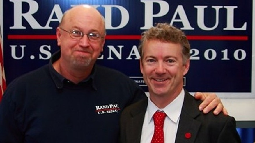 Senate candidate Rand Paul is seen with volunteer Tim Profitt in a photo distributed by Rand's opponent after Profitt was caught on video stepping on the head of a liberal activist. The Paul campaign says the photo was taken in January.