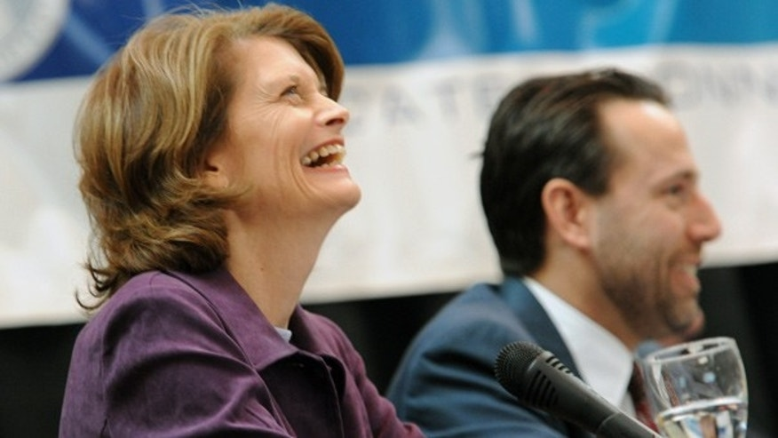 Oct. 26: Write-in Republican candidate Sen. Lisa Murkowski and Republican Joe Miller laugh during a debate in Anchorage.