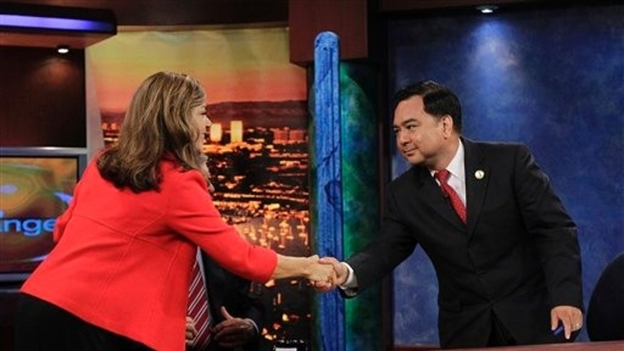 Democratic Congresswoman Loretta Sanchez, left, shakes hands with Republican state Assemblyman Van Tran after a debate for California's 47th Congressional seat in Huntington Beach, Calif., Wednesday, Oct. 13, 2010. (AP Photo/Jae C. Hong)