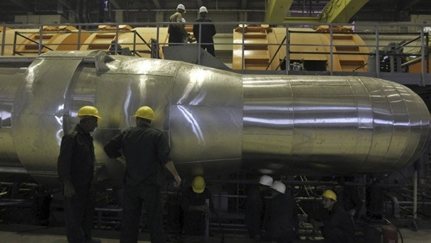 Oct. 26: Workers begin loading fuel into the core of the Bushehr nuclear power plant.