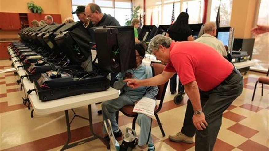 Voters take part in early voting at the Sun City Aliante Community Center Oct. 25 in Las Vegas. (AP Photo)