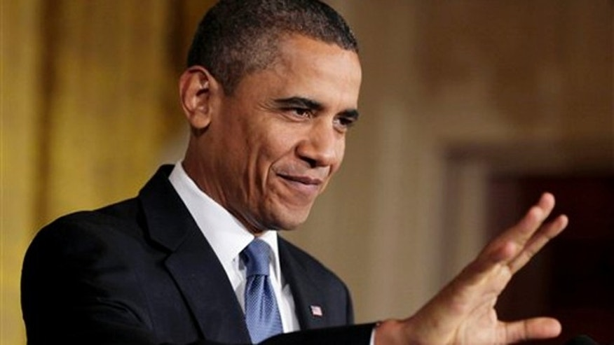 President Obama waves to members of the audience in the East Room of the White House in Washington Oct. 27. (AP Photo)