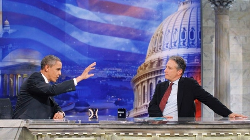 "Wednesday: President Obama gestures during a commercial break as he talks with host Jon Stewart at a taping of Comedy Central's ""The Daily Show with Jon Stewart,"" in Washington."