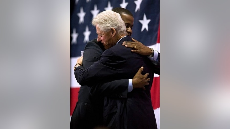 Florida Democratic senate candidate Kendrick Meek, left, hugs former President Bill Clinton as Clinton is introduced during a campaign rally for Meek Tuesday, Oct. 19, 2010 in St. Petersburg, Fla. (AP Photo/Steve Nesius)