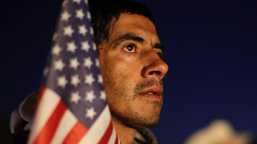 Daniel Moreno, of Elko, Nev., listens to speeches during a rally held by the Tea Party Express Monday, Oct. 18, 2010, in Elko, Nev. The Tea Party Express is touring the country by bus for the next two weeks and will make 29 stops crossing 20 different states until it ends in Concord, N.H. on Nov. 1. (AP Photo/Julie Jacobson)