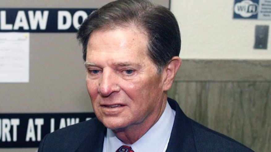 Oct. 26: Former House Majority Leader Tom DeLay shown here arriving at the Travis County courthouse in Austin, Texas for jury selection in his corruption trial.