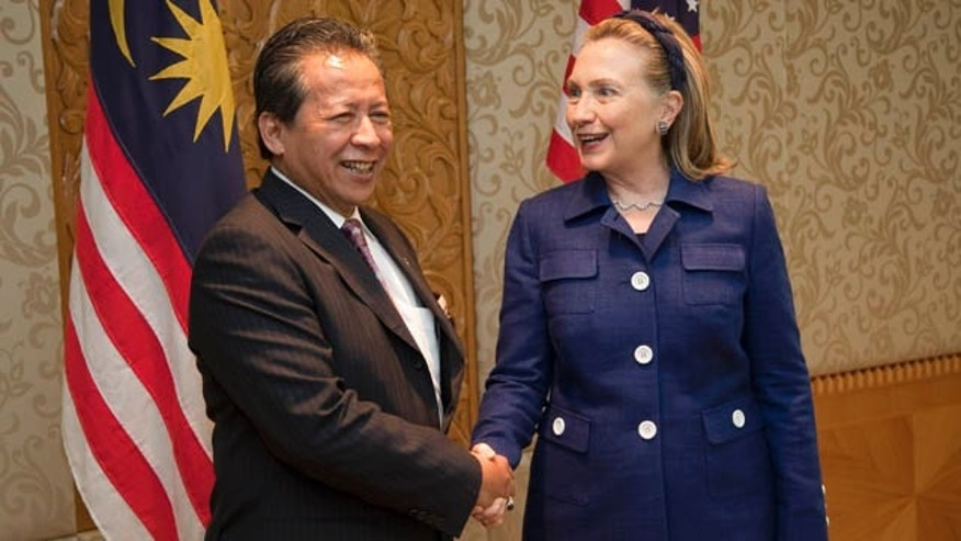 Nov. 2: U.S. Secretary of State Hillary Rodham Clinton, shakes hands with Malaysian Foreign Minister Anifah Aman at the Ministry of Foreign Affairs in Kuala Lumpur, Malaysia.