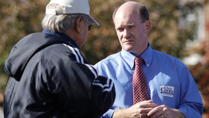Nov. 2: Delaware Democratic Senate candidate Chris Coons, right, talks with Venerando Maximo, outside a polling station in Dover, Del.