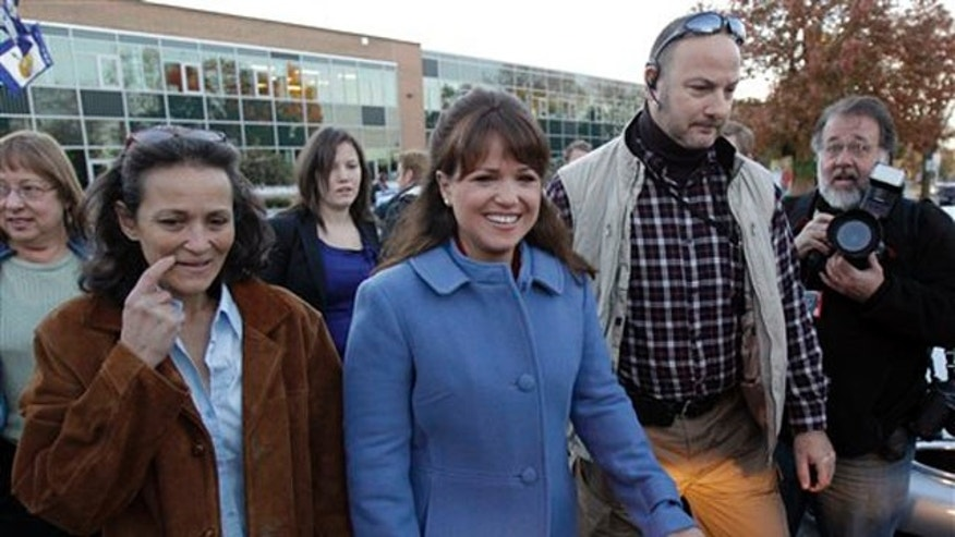 Delaware Republican Senate candidate Christine O'Donnell walks with her sister Jennie O'Donnell, left, after voting Nov. 2 in Wilmington, Del. (AP Photo)