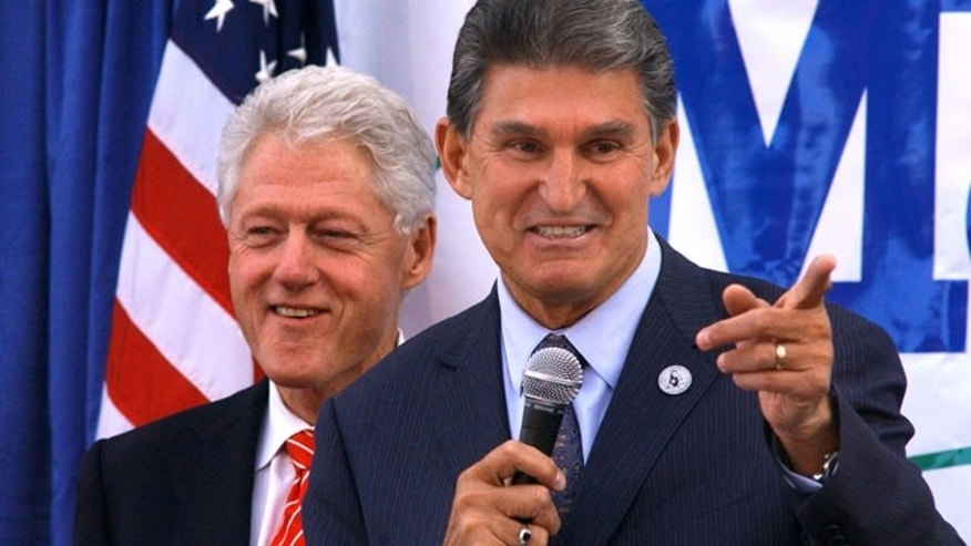 Nov. 1: Former president Bill Clinton smiles as W.Va. Governor Joe Manchin campaigns at Tamarack in Beckley, W.Va.