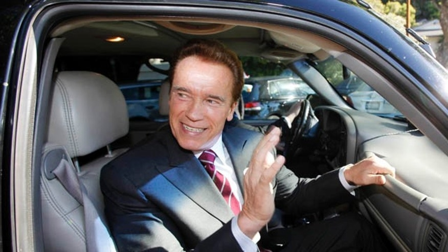 Nov. 2: California Gov. Arnold Schwarzenegger waves as he leaves after voting at an elementary school near his home in the Brentwood district of Los Angeles.