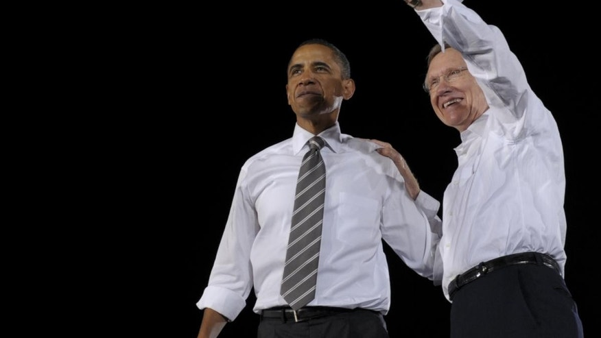 President Obama campaigning with Harry Reid. (AP Photo)