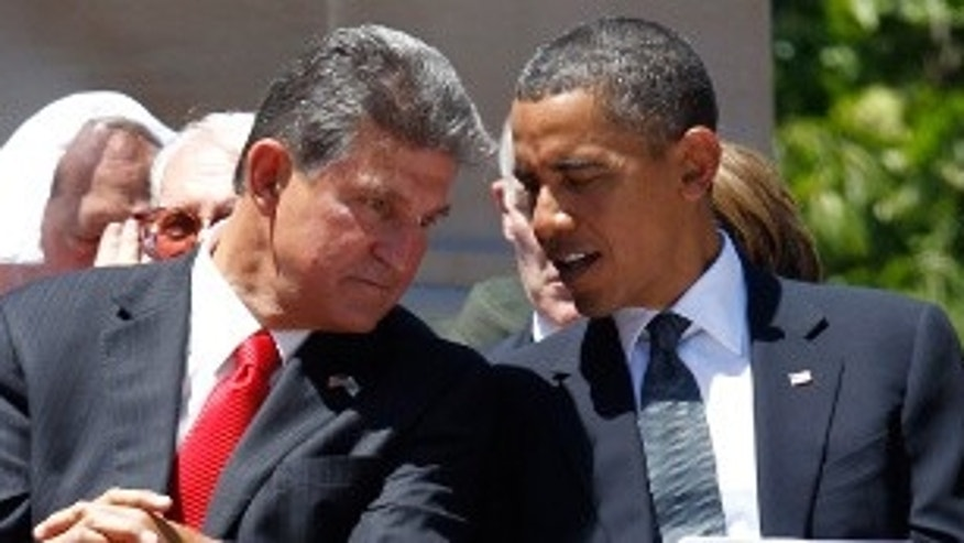 Senator-elect Gov. Joe Manchin (WV) with President Obama earlier this year. Manchin claims he will not toe the party line at the expense of his convictions. (AP Photo)