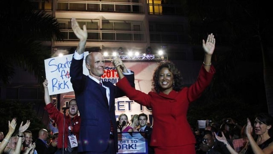 Nov. 3: Florida Republican gubernatorial candidate Rick Scott, left, and his running mate Florida Rep. Jennifer Carroll, R-Jacksonville, wave to supporters in Fort Lauderdale, Fla.