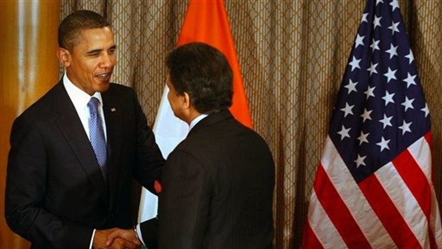 U.S. President Barack Obama, left, shakes hand with Mahindra & Mahindra Ltd. Managing Director Anand Mahindra at Obama's meeting with entrepreneurs in Mumbai, India, Saturday, Nov. 6, 2010. Obama arrived in India on Saturday, beginning a 10-day, four-country tour of Asia that will take him through some of the region's most vibrant democracies in search of U.S. economic and security benefits. (AP Photo/Rafiq Maqbool, Pool)