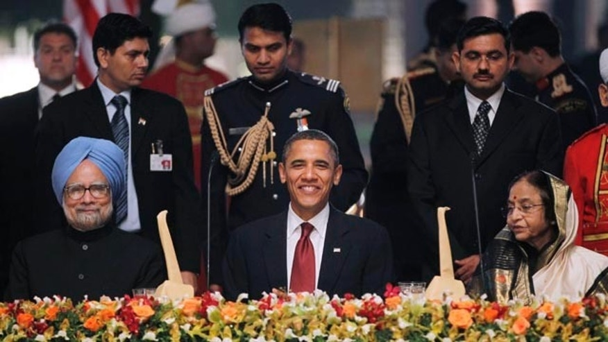 Nov. 8: Obama sits between India's President Prathiba Patil, right, and India's Prime Minister Manmohan Singh at a state dinner in New Delhi, India.