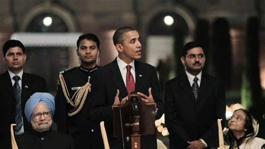 U.S. President Barack Obama, center, speaks as Indian Prime Minister Manmohan Singh, left, and President Pratibha Patil, right look on during a state dinner at Rashtrapati Bhavan, or President's Palace in New Delhi, India, Monday, Nov. 8, 2010. Indian and U.S. companies have discussed or signed over $14.9 billion in deals around Obama's trip, which will support 53,670 U.S. jobs, the White House said. (AP Photo/Manish Swarup)