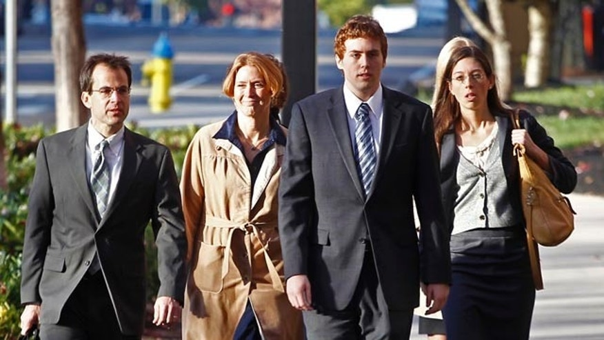 Nov. 12: David Kernell, third from left, walks to the Federal Courthouse with his mother, Lt. Col. Lillian Landrigan, second from left, and attorneys Wade Davies, far left, and Anne Passino, right, in Knoxville, Tenn.