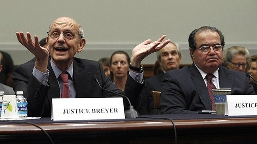 May 20: Supreme Court Justices Stephen Breyer (L) and Antonin Scalia testify before a House Judiciary Commercial and Administrative Law Subcommittee hearing on 'The Administrative Conference of the United States' on Capitol Hill.