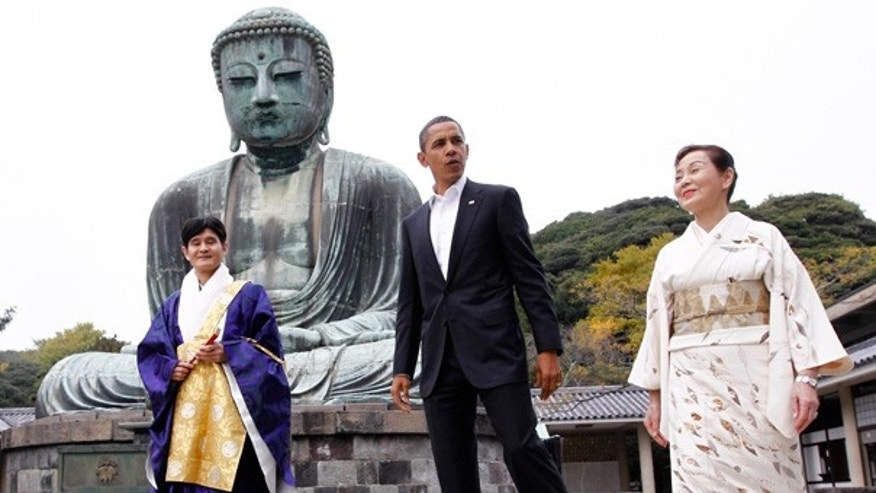 Nov. 14: President Barack Obama visits the Great Buddha of Kamakura with Michiko Sato, temple director, and Takao Sato, the 15th chief monk of the temple, at Kotokuin Temple in Kamakura, Japan.