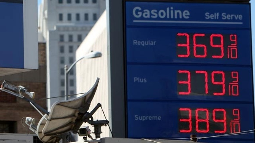 Wholesale gas prices rose in October for the fourth straight month. Shown here are high gasoline prices at a Chevron gas station in Los Angeles.