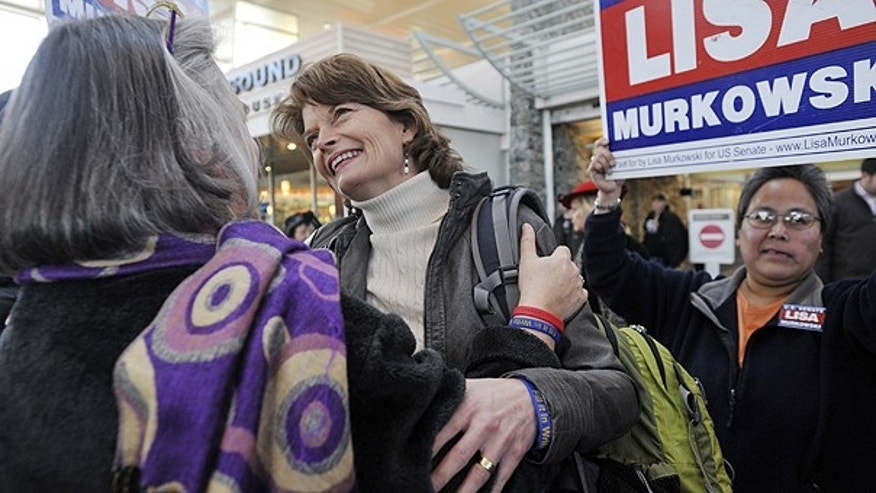Nov. 17: U.S. Senator Lisa Murkowski (R) Alaska, center, is greeted by her sister Carol Sturgelewski, left, upon her arrival at Ted Stevens International Airport in Anchorage.