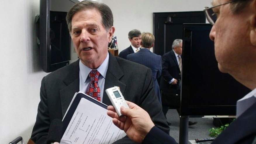 Oct. 26, 2010: Former House Majority Leader Tom Delay answers media questions during a break in jury selection for his money laundering and conspiracy trial.
