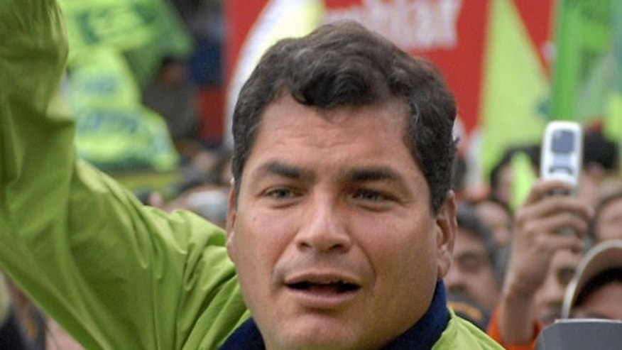 Ecuadorean Presidential candidate Rafael Correa greets supporters during his closing campaign rally in Quito, Ecuador, on Thursday, Oct. 15, 2006. Elections will be on Sunday Oct. 15. (AP Photo/Cecilia Puebla)