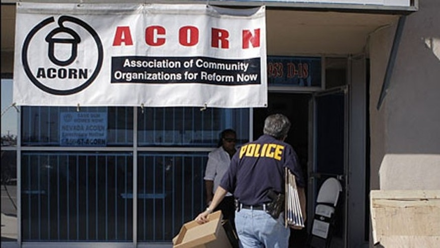 An investigator enters the ACORN office in Las Vegas, Oct. 7, 2008.