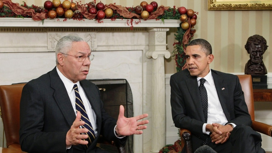 Dec. 1: Former Secretary of State Colin Powell, left, with President Barack Obama, talks about the importance of ratifying the New START Treaty, in the Oval Office at the White House in Washington, D.C.