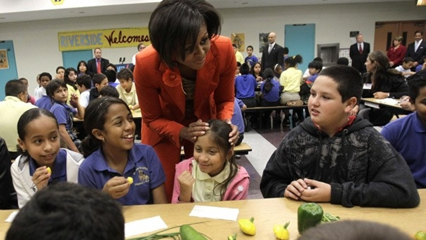 Nov. 22: First lady Michelle Obama talks with students as they taste fresh vegetables at an elementary school in Miami.