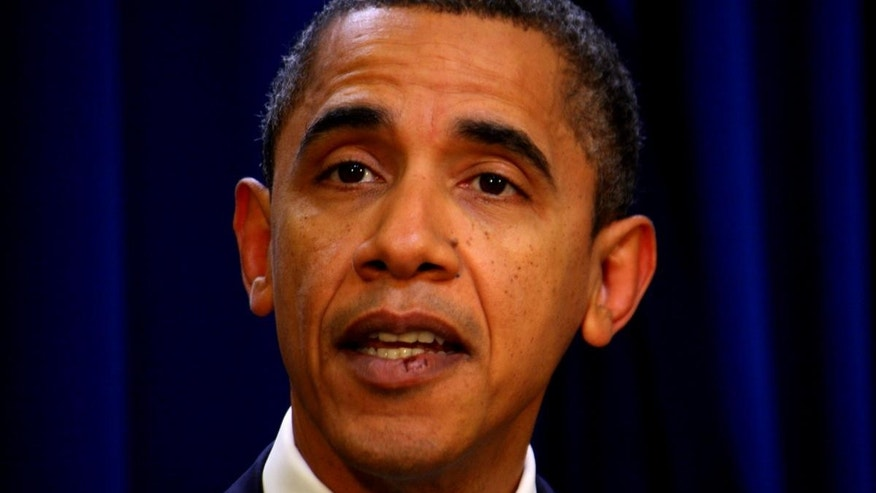 President Obama speaks to the press November 29. His stitches are easily visible. (Network pool photo)