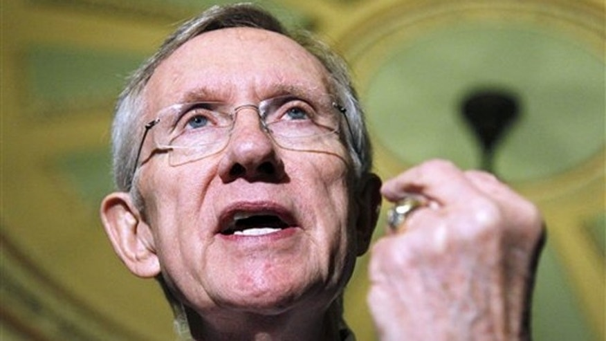 Senate Majority Leader Harry Reid gestures during a news conference on Capitol Hill Nov. 30. (AP Photo)