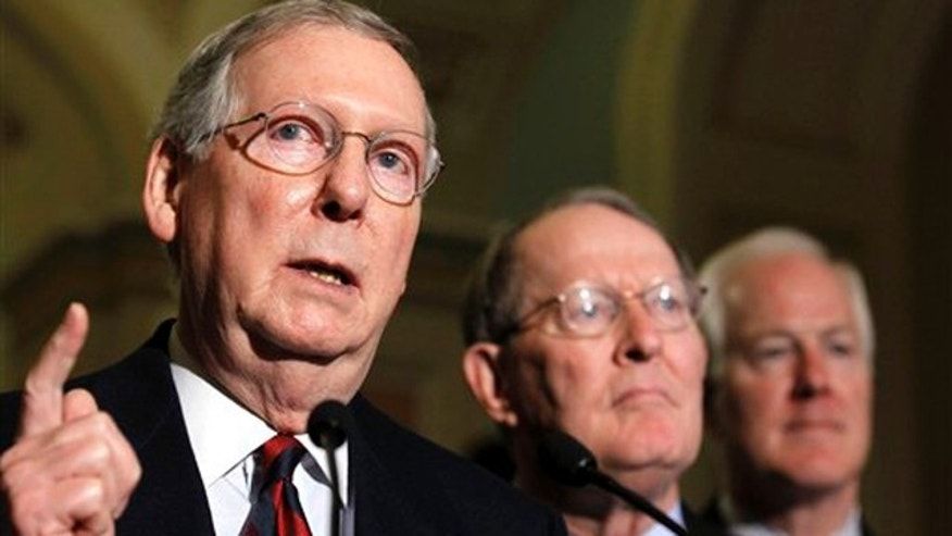 In this Nov. 16 photo, Republican Senate Leader Mitch McConnell, left, accompanied by Sen. Lamar Alexander, R-Tenn., center, and Sen. John Cornyn, R-Texas, speaks at a news conference on Capitol Hill. (AP Photo)
