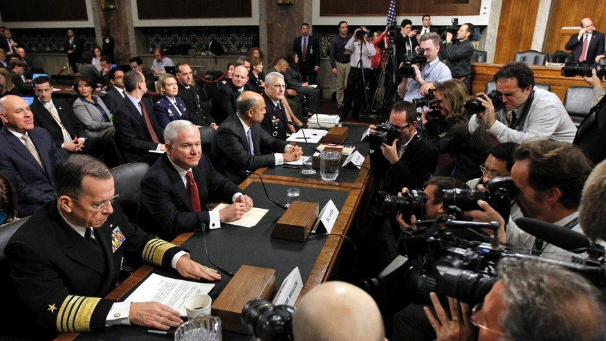 Dec. 2: From left, Joint Chiefs Chairman Adm. Michael Mullen, Defense Secretary Robert Gates, Defense Dept. general counsel Jeh Johnson, Gen. Carter Ham, commander of the U.S. Army Europe, before testifying on gay policy.