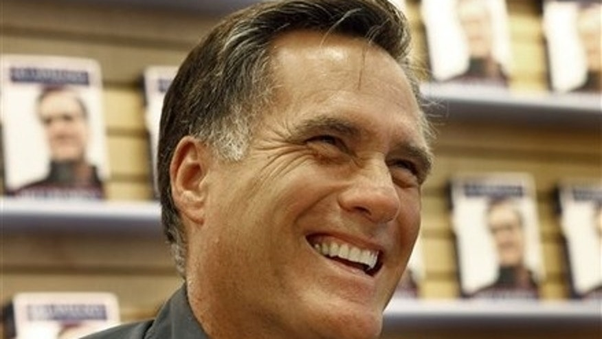 "Former Republican presidential candidate and Massachusetts Gov. Mitt Romney smiles at a book signing for his book ""No Apology: The Case for American Greatness"" at a Barnes and Noble, Wednesday, April 7, 2010, in Manchester, N.H.  (AP Photo/Mary Schwalm)"
