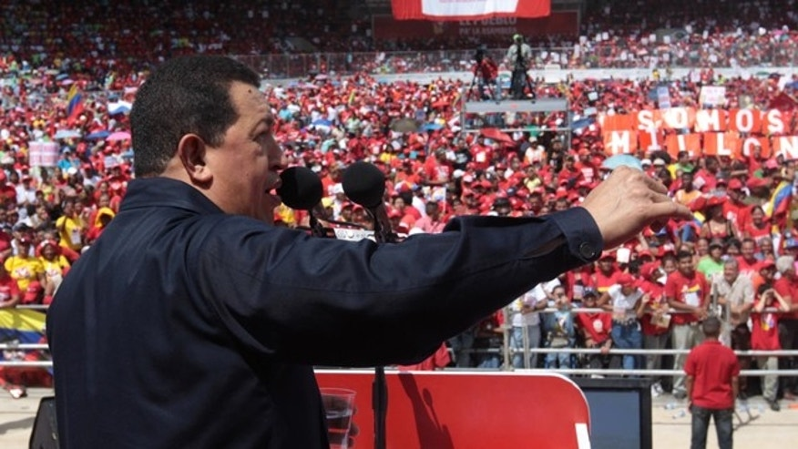 In this photo released by Miraflores Press Office, Venezuela's President Hugo Chavez speaks to members of his party, the United Socialist Party of Venezuela (PSUV), at a campaign rally for upcoming congressional elections in Caracas, Venezuela, Sunday July 25, 2010.  Chavez threatened to halt oil sales to the U.S. if Venezuela faces any military attack by Colombia. (AP Photo/Miraflores Press Office, Efrain Gonzalez)