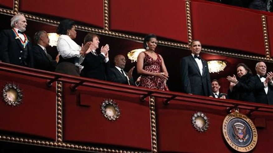 President Obama and first lady Michelle Obama are applauded by recipients of the 2010 Kennedy Center Honors at the Kennedy Center in Washington Dec. 5. (AP Photo)